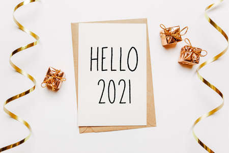 hello 2021 note with envelope, gifts and gold ribbon on white background. merry christmas and New Year concept