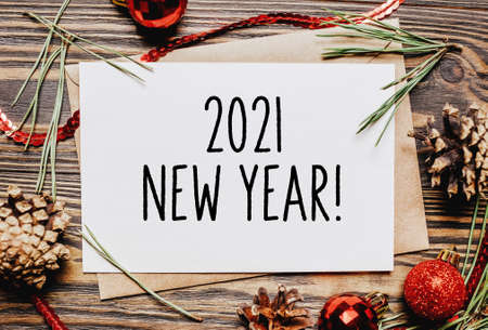 Merry christmas and merry new year concept notebook with text 2021 New Year