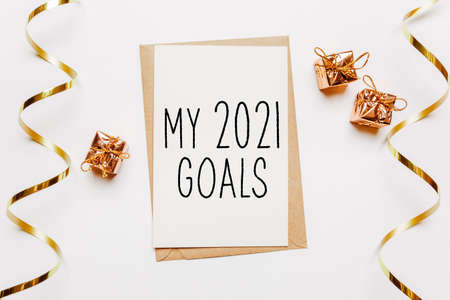 Blamy 2021 goals nk note with envelope, gifts and gold ribbon on white background. merry christmas and New Year concept Reklamní fotografie
