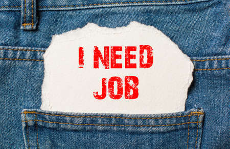 I need job on white paper in the pocket of blue denim jeans