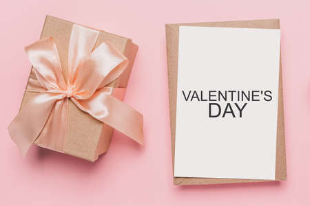 Gifts with note letter on isolated pink background, love and valentine concept with text Valentines Day