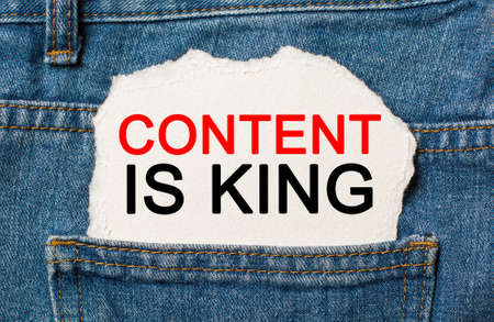 Content is King on torn paper background on jeans business and finance concept 版權商用圖片