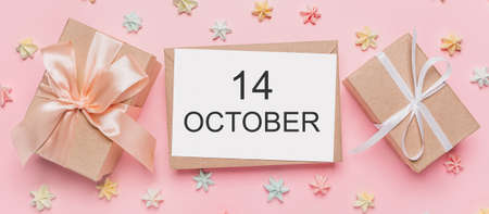 Gifts with note letter on isolated pink background with sweets, love and valentine concept with text 14 October