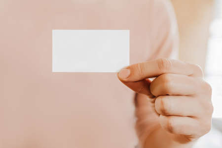 Man holding a business card with blank background 版權商用圖片