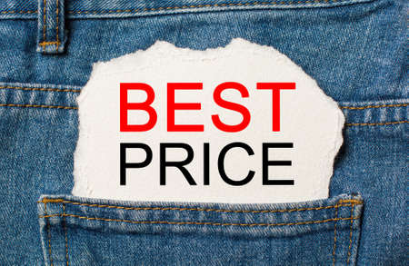 BEST PRICE on torn paper background on jeans business and finance concept 版權商用圖片