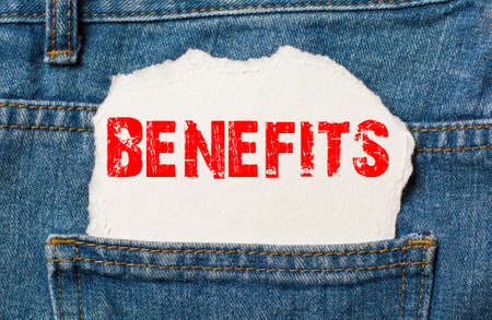 benefits on white paper in the pocket of blue denim jeans