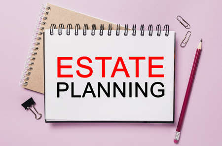 Text Estate Planning on a white sticker with office stationery background. Flat lay on business, finance and development concept