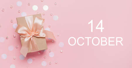 Gifts on pink background, love and valentine concept with text 14 October