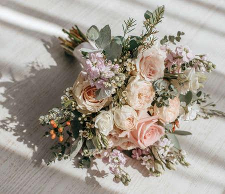 Wedding bouquet of peonies flowers on the floor of the newlyweds 版權商用圖片