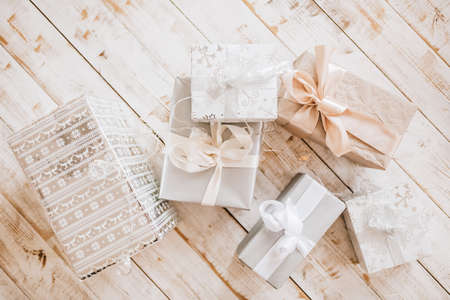 New Year gifts and Christmas toys on wooden floor