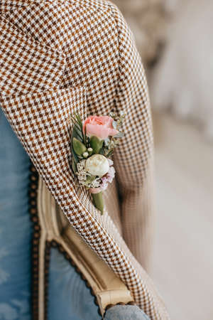 Suit for groom with a wedding flower boutonniere