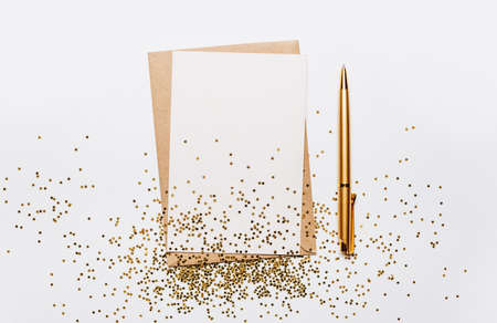 Blank note with envelope, pen and gold glitter stars on white background