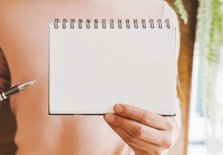 Man holding a notebook with blank background 版權商用圖片