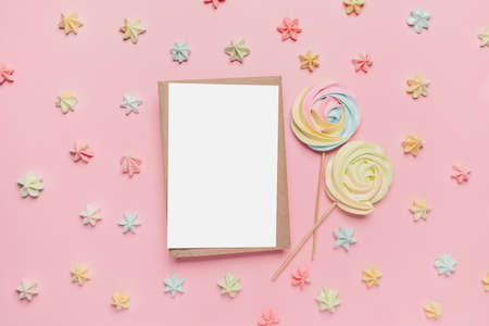 Gifts with note letter on isolated pink background with sweets, love and valentine concept