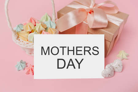 Gifts with note letter on isolated pink background with sweets, love and valentine concept with text mothers Day 版權商用圖片