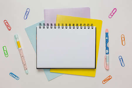 Notepad, exercise book and pen on the desk. Mock up in copy space office on white background. Back to school 版權商用圖片