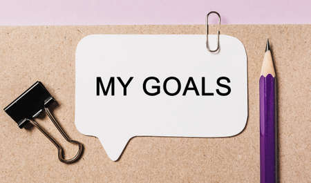 Text My goals on a white sticker with office stationery background. Flat lay on business, finance and development concept 版權商用圖片
