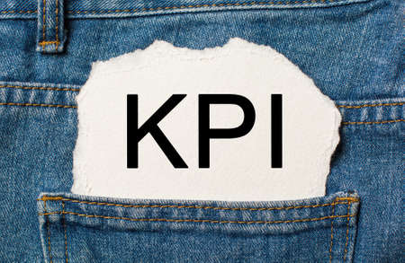 KPI on torn paper background on jeans business and finance concept 版權商用圖片