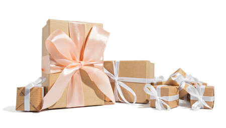 A lot of gifts tied with a white ribbon on a white isolated background. Celebration and congratulations holiday concept