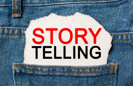 Storytelling is the best marketing on torn paper background on jeans business and finance concept