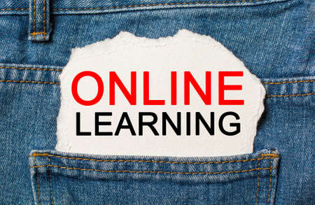 online Learning on torn paper background on jeans study and education concept