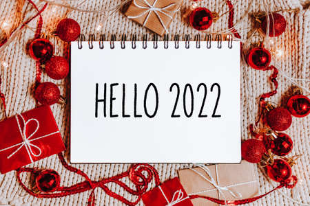 Merry christmas and merry new year concept with gift boxes and greeting card with text Hello 2022 版權商用圖片