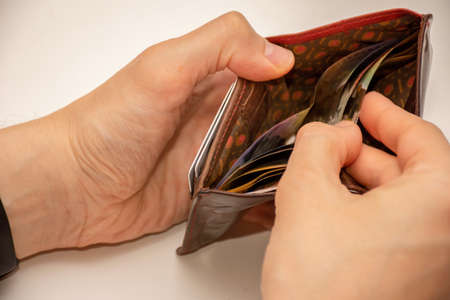 Hands holding wallet with australian dollars - low income due to coronavirus
