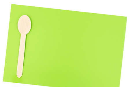 Eco friendly disposable cutlery utensils on green background. Bamboo wooden spoon. Zero waste concept Stock fotó