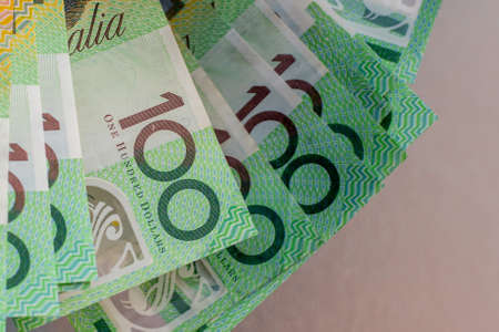 Australian dollars 100 banknotes on glass table background. Finance and payment concept. Stock fotó