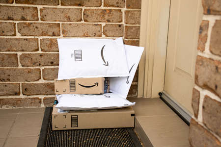Sydney, Australia - 2020-10-17 Amazon prime boxes and envelopes delivered to a front door of residential building Redactioneel