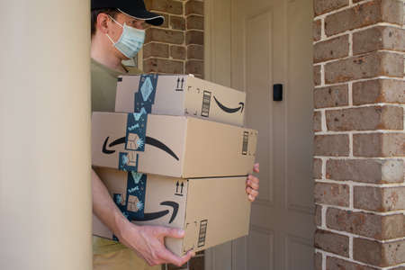 Sydney, Australia - 2020-11-29 Amazon prime boxes and delivered to a front door of residential building during the COVID-19 pandemic.