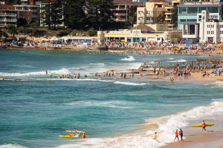 Sydney, Australia 2021-01-26 Extremely overcrowded Cronulla beach on Australia day. People relaxing, swimming and sunbathing on hot summer day. Australian lifestyle