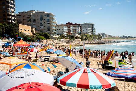 Sydney, Australia 2021-01-26 Extremely overcrowded Cronulla beach on Australia day. Umbrellas on the beach. Australian lifestyle