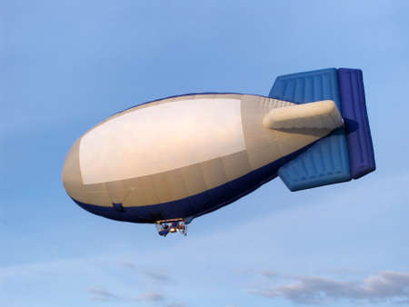 blimp: Blimp with a pilot on the background of blue sky.