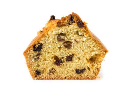 spongy: Slice of cake with raisins isolated on white background.