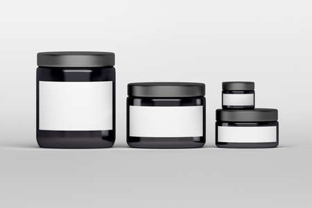concentrate: Mockup of a set of skin care cream products packages. Black plastic shiny cosmetics containers with white blank labels on white background.