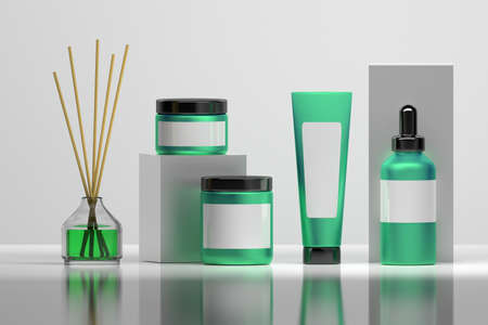 Set of cosmetic bottles in pure green and white colors with glassy home perfume diffuser. Mock-up with blank labels for cosmetic packaging. Stock Photo