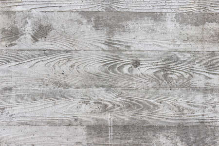 Surface of the gray concrete wall with pattern.