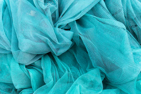 Randomly arranged cloth fabric which is used at the construction places as a protection.