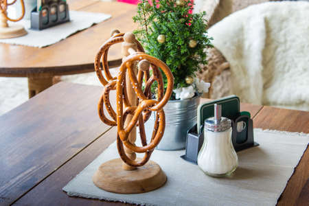 Outdoor cafe table decorated with traditional German pretzels.