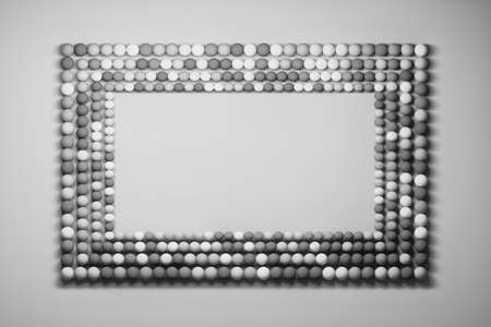 Frame made of rows of small randomly colored balls. Image with copy blank space in black and white colors. 3d illustration.