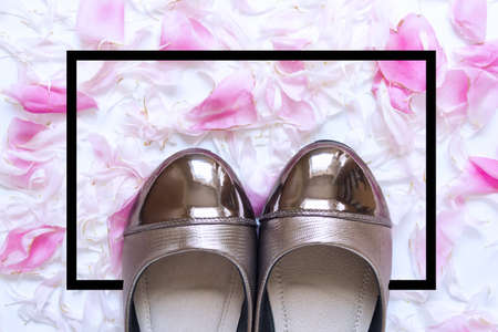 Female flat shoes with golden shiny decoration with romantic peony flowers and black border frame.
