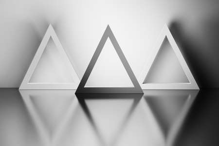 Monochrome image of three triangles in a room over reflective mirror surface. 3d illustration. Reklamní fotografie