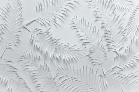 Pure white flat lay pattern with handmade paper cut tropical plant palm leaves feathers on white background. Reklamní fotografie