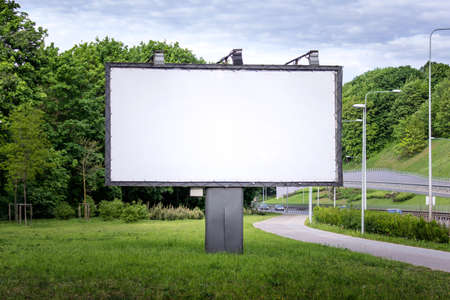 Large commercial advertisement billboard with empty blank space located outside next to road and sidewalk. Reklamní fotografie
