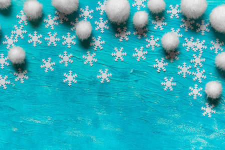 Christmas New Year texture blue background with concept falling snow made of snowflakes and white fluffy balls.