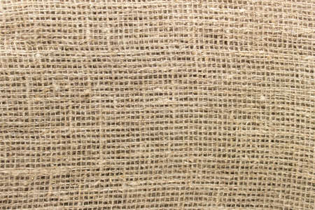 Texture of sackcloth rough fabric cloth with visible uneven threads.