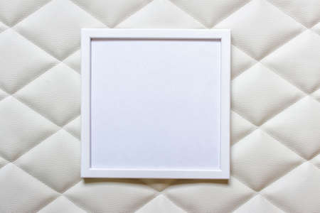 White picture frame with white blank space on white luxury tufting cloth fabric.