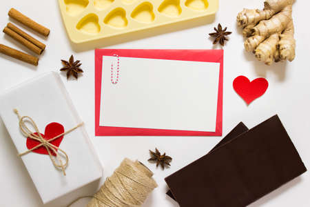 Valentine day cooking dining gift preparation arrangement, template with presents, chocolate, herbs and empty blank message letter.