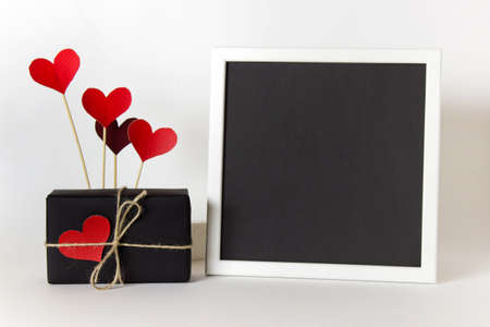 Empty blank frame with black paper and decorative heart love affection Valentine day elements.
